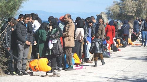 52115208 - refugees on the greek shore