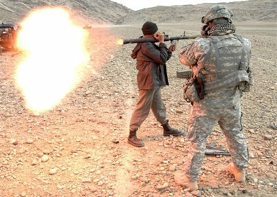 Afghan_National_Police_officer_fires_an_RPG