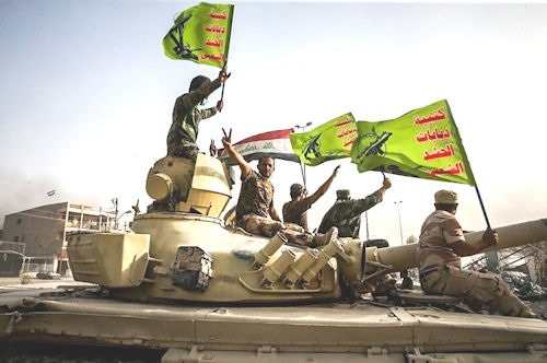 Raising_flag_of_Iraq_and_Popular_Mobilization_Forces_after_defeating_DAESH